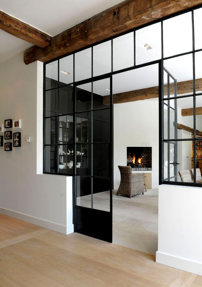 Clean modern white walls with rustic wrought iron winodw/doorway. #woodbeams