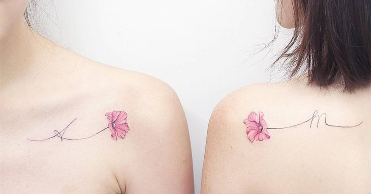 Tattoo Artist: Mini Lau. Tags: styles, Illustrative, Letters, Latin Script, Initials, A, M, Nature, Flowers, Poppies, Matching, Best Friends Matching Tattoos, Sibling Matching Tattoos, Sister Matching Tattoos, love, For Best Friends, Family, For Sisters. Body parts: Shoulder, Shoulder Blade.