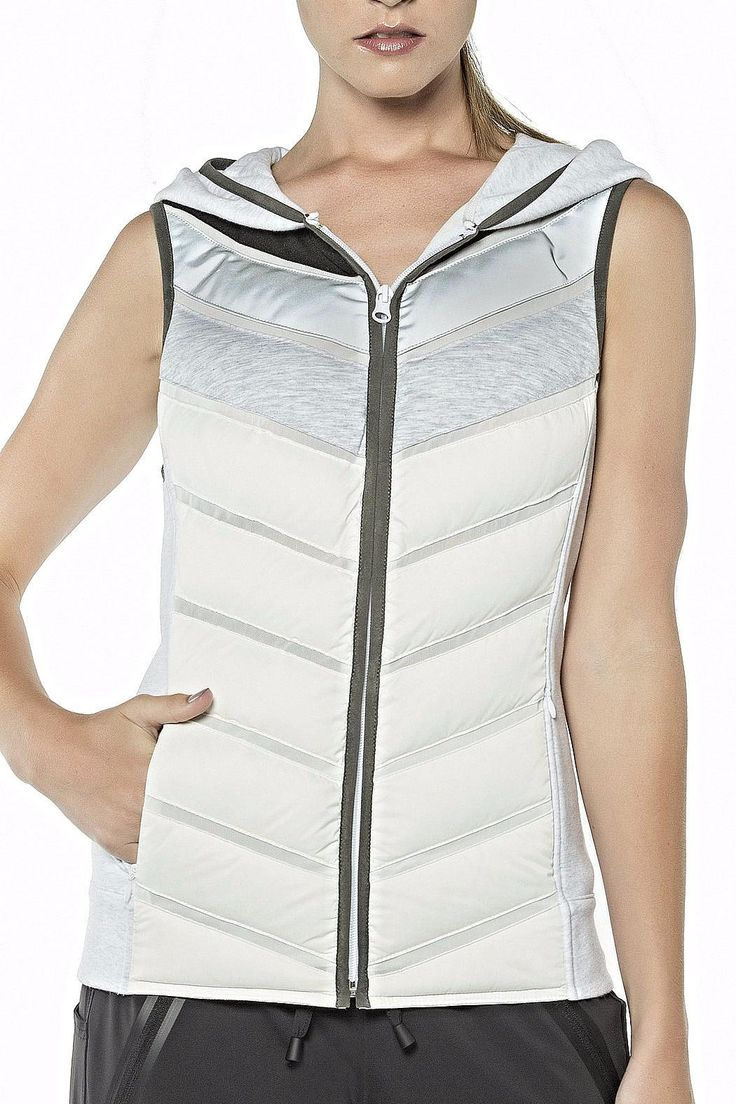 PACKABLE MOTO VEST Style # BLVC091CB00 This stylish vest to take you into Spring will be great with a turtleneck or a tank top! Active wear that goes into the evening  Blanc Noir is signature city style fused with performance features and fabrics that connect  contemporary and active fashion. Blanc Noir engineers its garments to offer the latest in breakthrough fabric technology and functional detail innovations which motivate and support the increasingly high tech lifestyles we lead.  Self…