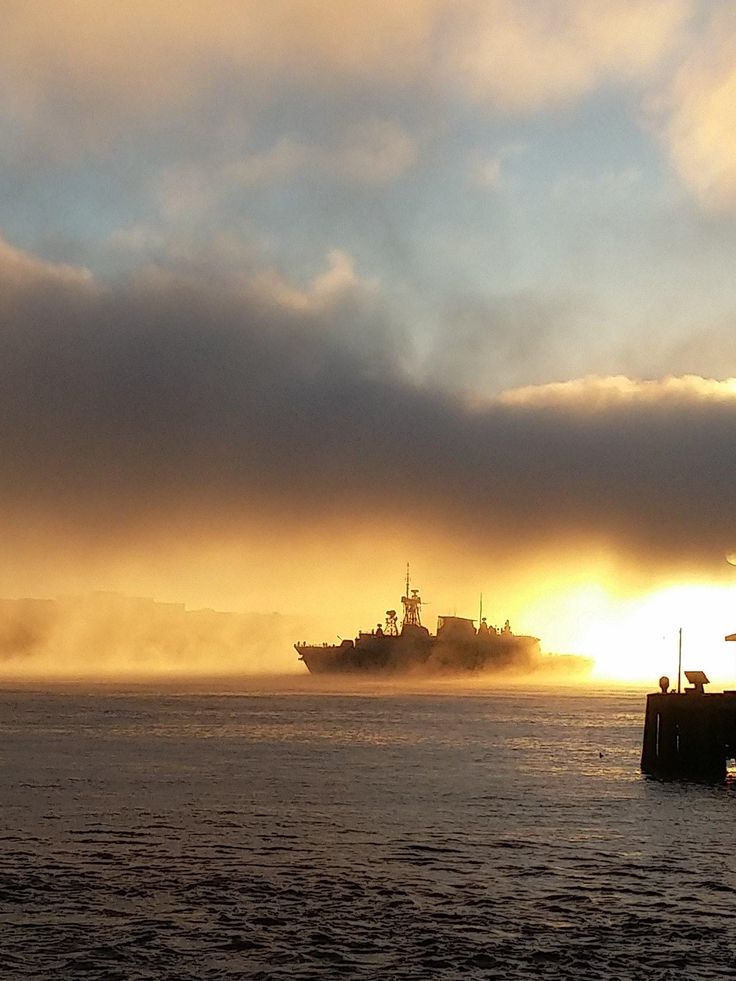 HMCS Ville De Quebec coming out of the fog [OC]