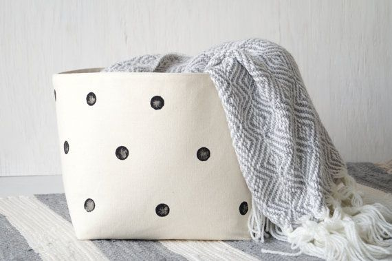 Scandinavian design inspired off-white cotton canvas storage basket with handpainted, black polka dots will fit perfectly and cozy up any style home. Spice up your living room, kids room or nursery, or just store your craft supplies, bathroom items, linens, toys, socks and other items in this hard wearing storage bin.  SIZE Storage basket measures approx. 24 cm x 24 cm x 23 cm (H) / 9.5 x 9.5 x 9 (H).  MATERIALS Inside and outside is very durable and hard wearing 100% cotton canvas in n...