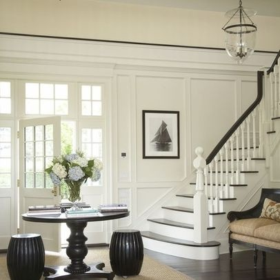 love the round table and stools at front door with stairs to the side.