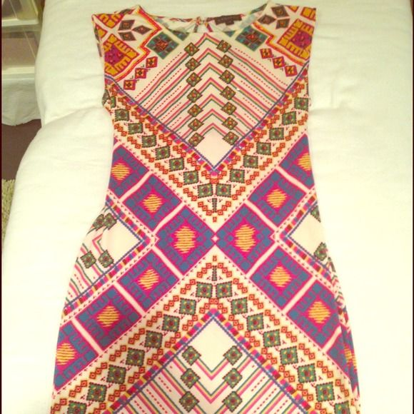 """Rampage dress Adorable dress with tiny beads on it and cross cross straps in back. Not too short sits right above my knees and I'm 5""""4'. Worn once, then dry cleaned. Rampage Dresses"""