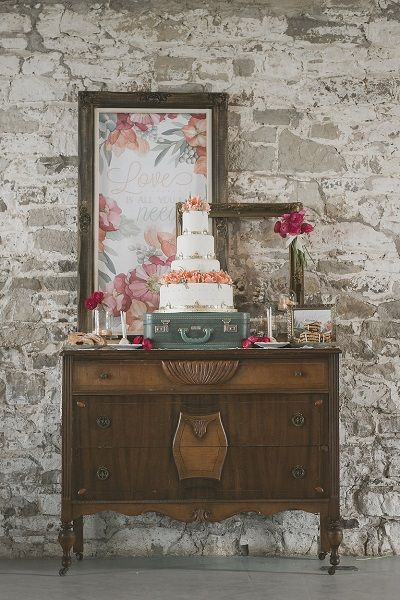 Vintage sweets table in ivory, peach and gold. Dresser from @warehouse84 Flowers by @suegallodesigns Photo @allykristensen