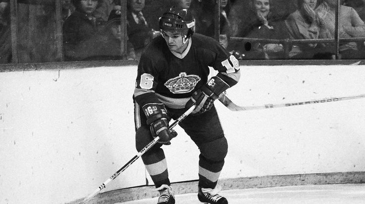 1977: Marcel Dionne scores a goal in the Los Angeles Kings' 3-3 tie against the Pittsburgh Penguins at the Forum in Inglewood, California, to become the first player in franchise history to reach 100 points in a season. Dionne also becomes the first player in NHL history to score 100 points with two teams.