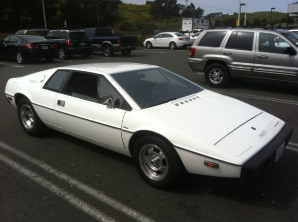 This 1977 Lotus Esprit-has been nicely restored by an enthusiast. The car looks especially good in the white finish, whether or not you have a James Bond fetish. We suspect this one will sell quickly, as the interior work, subtle color scheme, and super clean engine bay are traits we rarely see in these early Esprits. Find it here on eBay in San Franscisco, with a $20,000 Buy it Now.:  Limo, Trailers, 1977 Lotus, Lotus Esprit Lik, Motorcycles Cars Machine, Worst Cars, British Cars, クルマーLotus 徒然なるままに, Lotus Cars