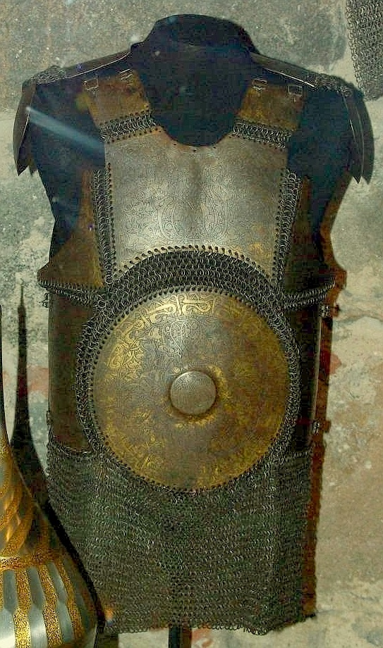 Armour of the Ottoman Empire. 16th to 17th century krug (chest armor) as worn by fully armored cavalryman in conjunction with migfer (helmet), dizcek (cuisse or knee and thigh armor), zirah (mail shirt),  kolluk/bazu band (vambrace/arm guards), and kolçak (greaves or shin armor).