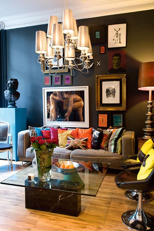 Oversized Art to give a Grandeur Feel in this Eclectic Black Walled & Colourful Accent Living room