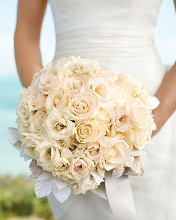 Lush white roses mixed with velvet millinery leaves