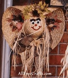 How to make a simple straw hat scarecrow wreath with a smiling scarecrow face to greet visitors.