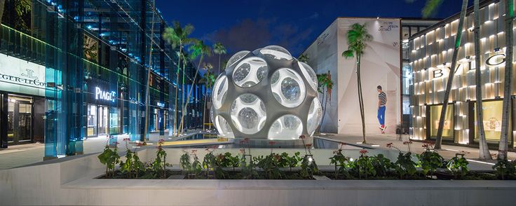 """Bulgari, Fly's Eye Dome, and Fugimoto's """"waterfall."""" Palm Court, Miami Design District. Master architect: SB Architects. Photograph by Robin Hill."""