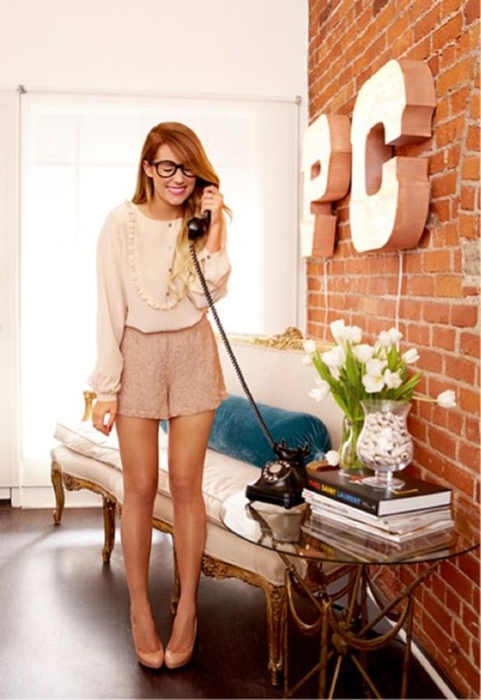 I love this outfit designed by Lauren Conrad. It is all neutral tones of pink. Both pieces of this outfit are oversized but because she tucked in the shirt to the shorts it helps to define the waistline and keeps the outfit from looking too slouchy. The different tones of pink keep it from clashing and the nerdy-oversized glasses are a great touch!