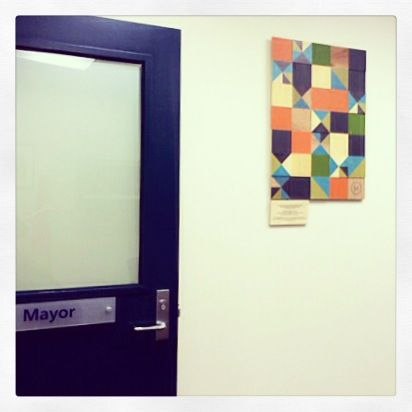It was lovely to get into the office to discover an email from the Mayor of out home town!  He was so delighted to have received our donated piece to the Local Council... That he couldn't resist hanging it in his own office!!!