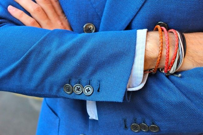 blue jacket close up detail bracelets men fashion