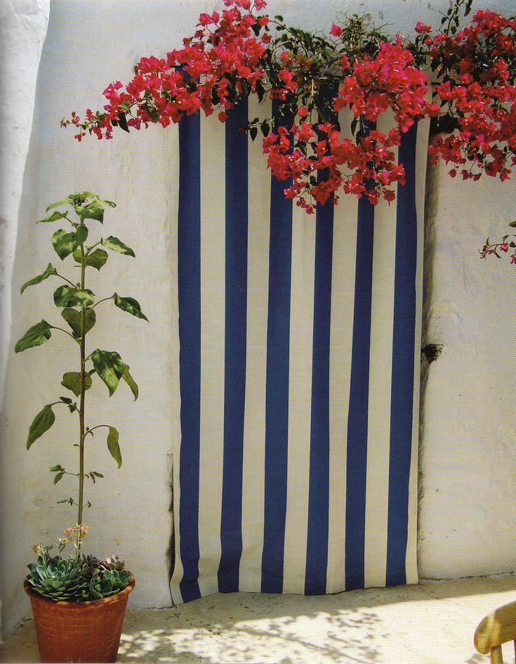 """Stripes and bougainvillea at the Patmos house of interior designer John Stefanidis, by Fritz von der Schulenburg"""