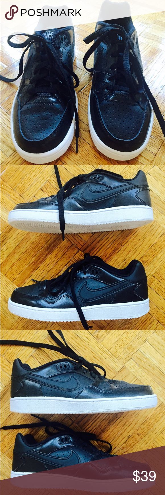 Nike Women's Black Air Force One Sneakers Never worn Nike Air Force One Sneakers. In great condition! Nike Shoes Sneakers