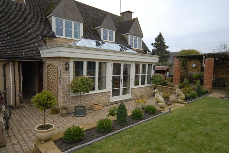 Hardwood Orangery in Oxfordshire  This Orangery Designed to fit into the garden space and create this lovely kitchen Extension