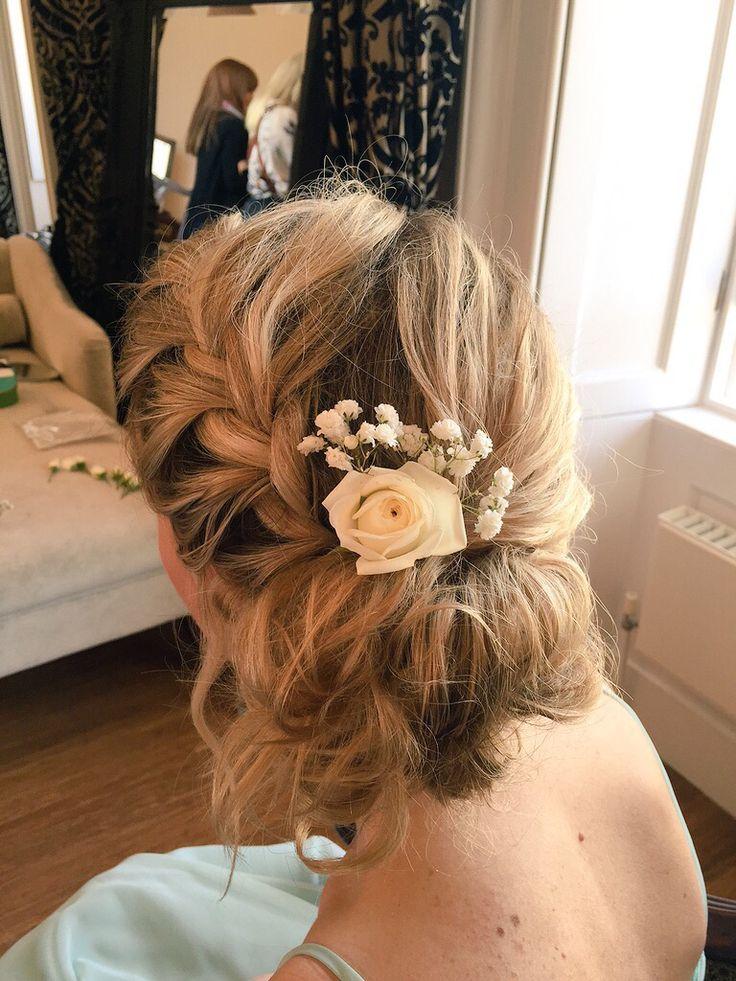 Textured Side Bun With Braid And Fresh Flowers Wedding