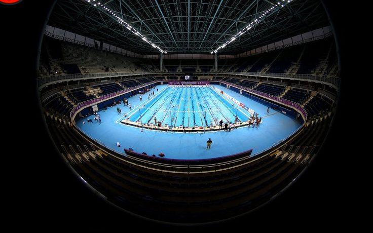 Swimming records fall as Phelps collects 19th gold