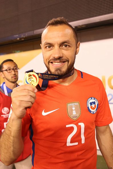 #COPA2016 #COPA100 Marcelo Diaz of Chile shows his medal after the championship match between Argentina and Chile at MetLife Stadium as part of Copa America Centenario...