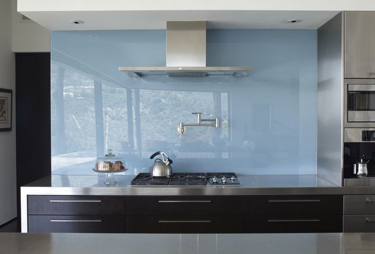 The glass backsplash - I've seen a lot of this lately in Aus. May be coming to the US. Seamless, easy to clean, comes in a variety of colors. Contemporary design.