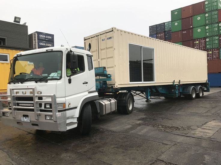 40ft shipping container modified to include sliding doors and window