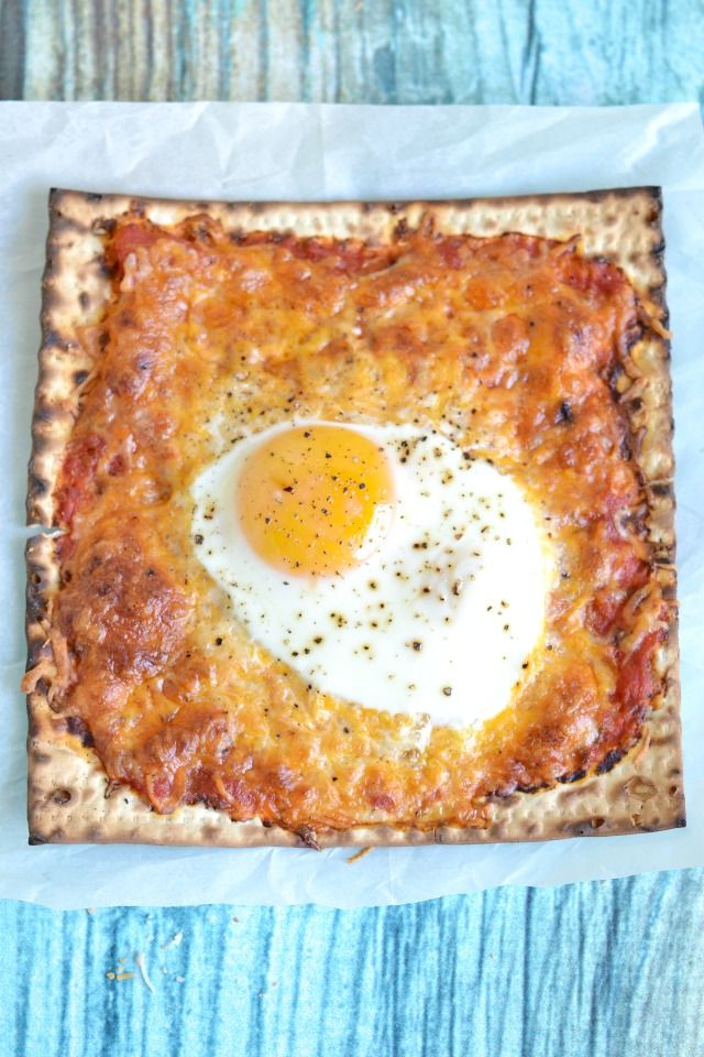 Matzo pizza with an egg is just one of the 14 ways we are loving matzo right now. Thanks Kitchen-Tested.