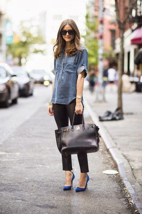 Blue gray denim check skirt with black leather tight pant and shining black leather hand bag and navy blue high heels pumps