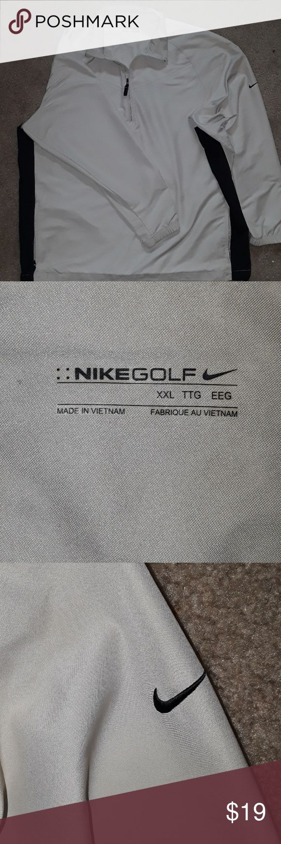 Nike Golf Jacket Tan with black stripe under arm.  Quarter zip with zipper pockets.  Adjustable waistband.  Great condition no stains, flaws or rips, just too big for me. Nike Jackets & Coats