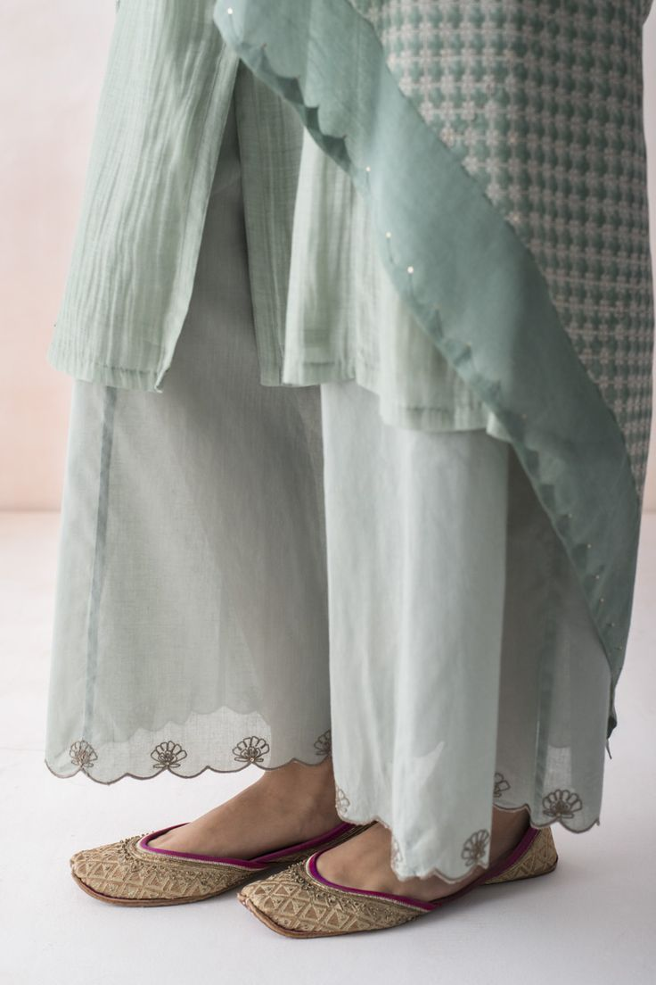 ALAIA  Jaal chandi farshi in delicate mulmul with embroidered lotus butahs strewn along the hem.