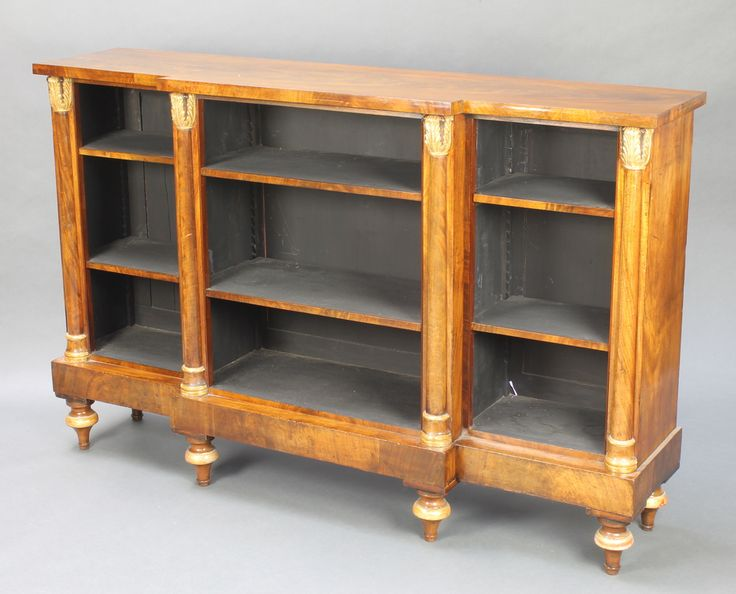 """Lot 990, A Regency mahogany breakfront bookcase fitted adjustable shelves and column decoration, raised on 6 bun feet 39""""h x 61""""w x 14 1/2""""d est £600-800"""