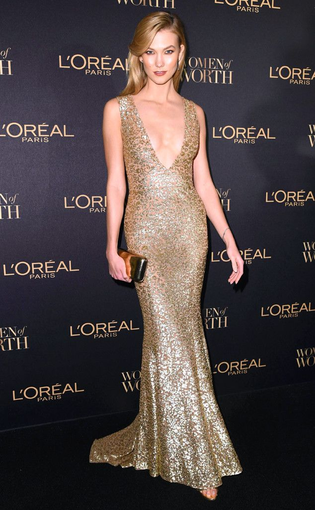 Karlie Kloss from The Big Picture: Today's Hot Pics  Golden goddess! The model looks statuesque in a gold gown at the L'Oreal Paris Women of Worth event in New York City.