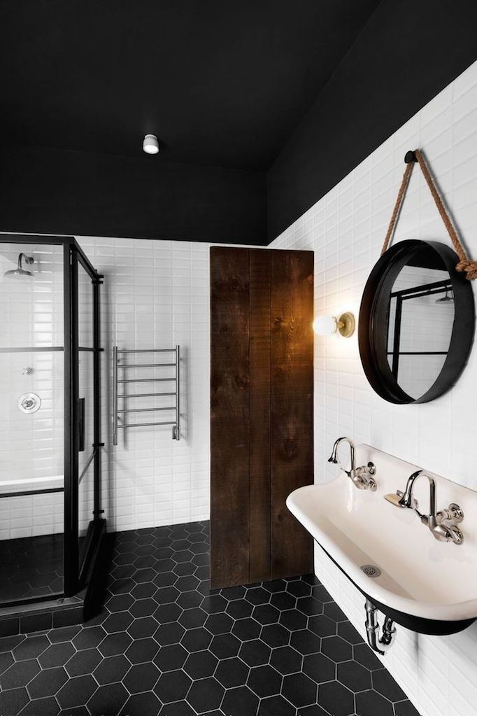 black hexagon tiles black ceiling and floor dark brown organic accents black and white sink basin