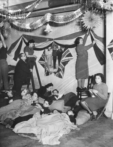 London, 20th December 1940: During WW II Westminster Council offered a prize for the best dressed shelter. These occupants have used Christmas decorations and flags, as well as portraits of the King and Queen and Winston Churchill. (Photo by William Vanderson/Fox Photos/Getty Images)