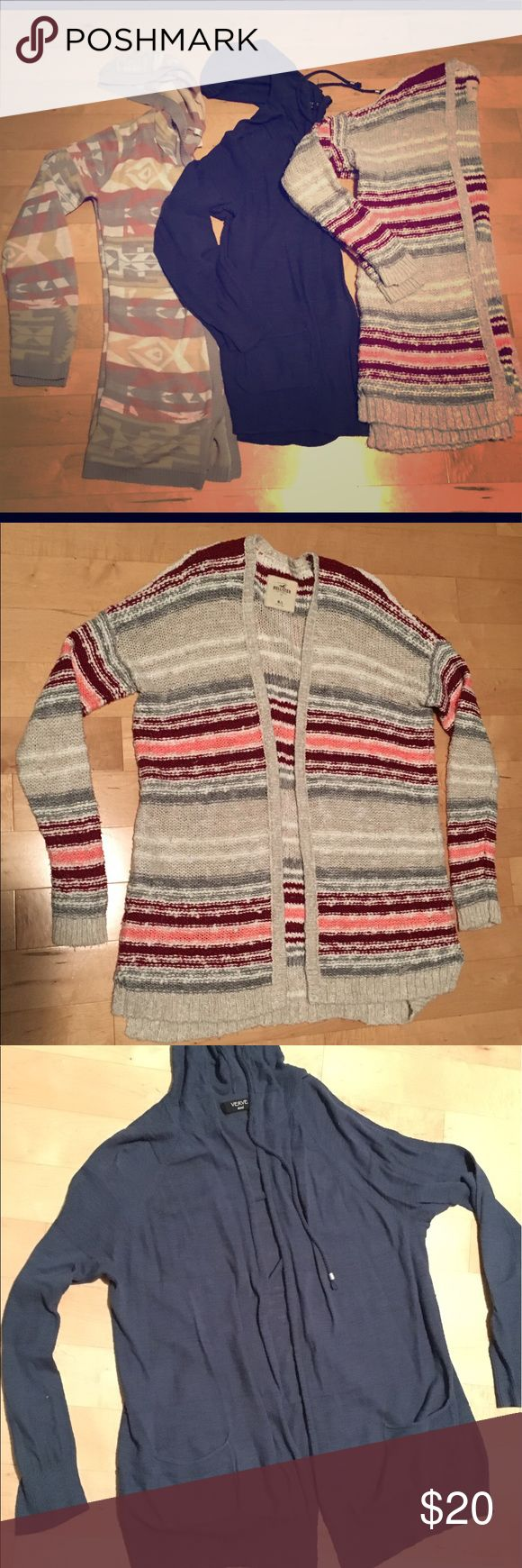 "3 for 20$ Long Sweater Bundle Verve Ami navy open sweater with hoodie and pockets (stitching has strips) – size large but would fit medium ""Say What?"" Tribal print open sweater size M (tan, gray, salmon, and white)  Hollister striped pink, tan, red, and white sweater, supper thick and fizzy, has small hole on shoulder but not very noticeable and can be easily fixed. Size ""M/L"" Trades and reasonable offers are welcome ☺ All in used/good condition, no rips, pilling, or pulls; smoke free home…"