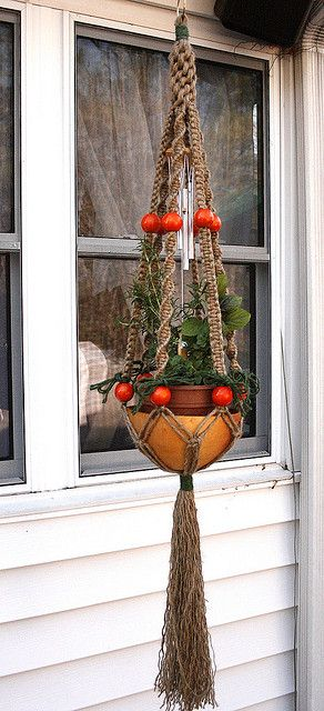 Fiesta! macramé plant holder by Macramaking...   Not sure sure about the windchime but I like those oversized beads!