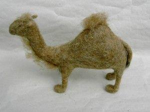 Tiere an der Krippe: Kamel