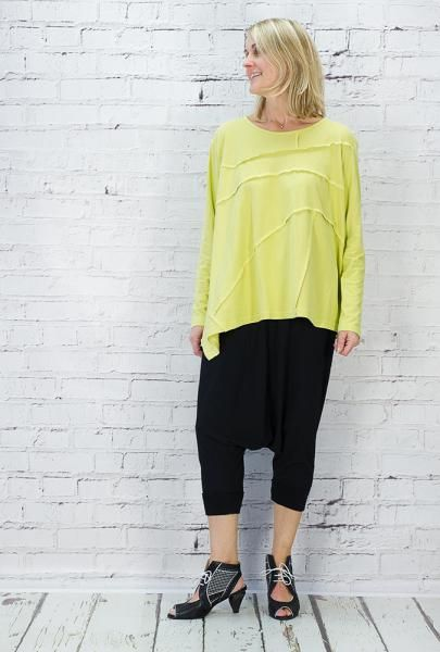 Moyuru long sleeved, round necked jersey T shirt, with an asymmetric hem, overlocked panels front and back. 100% cotton.