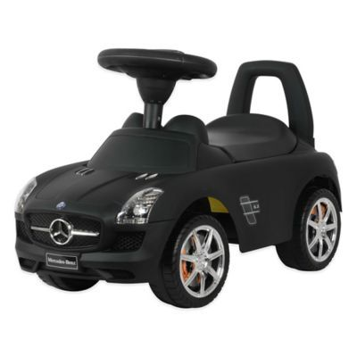 Featuring an authentic logo, the Licensed Mercedes SLS AMG Push Car is a replica of a Mercedes and has 4 rugged tires. It features a soft seat with a storage space underneath, a steering wheel, and a handle at the rear end for support.