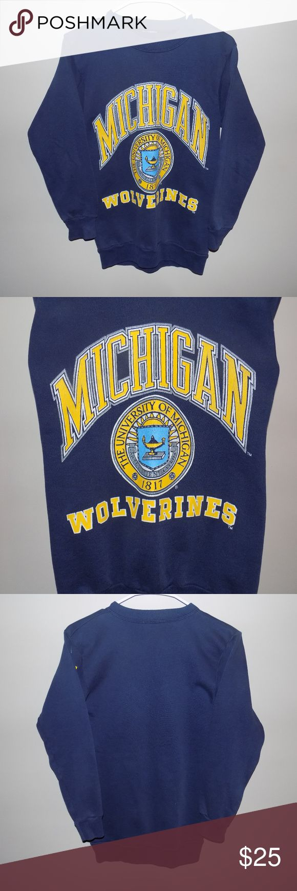 Vintage Unisex Michigan Wolverines Crewneck Vintage Unisex Michigan Wolverines Crewneck Sweatshirt! Still in great condition (9/10)! The tag is missing, but it fits like a Small or a Medium. The graphic on the front does have very light cracking, but is still in great condition and it has a super cool vintage feel to it! Vintage Sweaters Crewneck