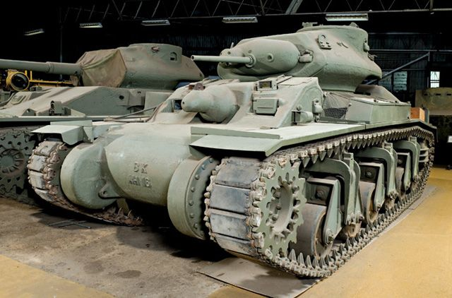 A World War II Australian AC-1 'Sentinel' Cruiser tank, manufacturer: NSW Government Railways. Crew: five. Engine: three Cadillac series 39-75 V8 petrol engines. Weight: approximately 28,000kg combat laden. Armament: one 2-pounder gun, and an original 2-pounder gun, not fitted