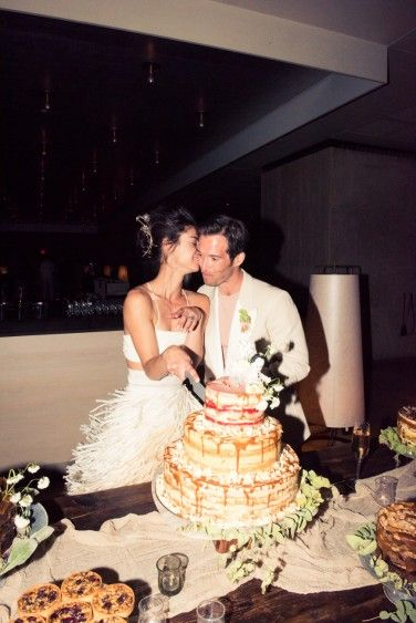 Cutting the wedding cake.