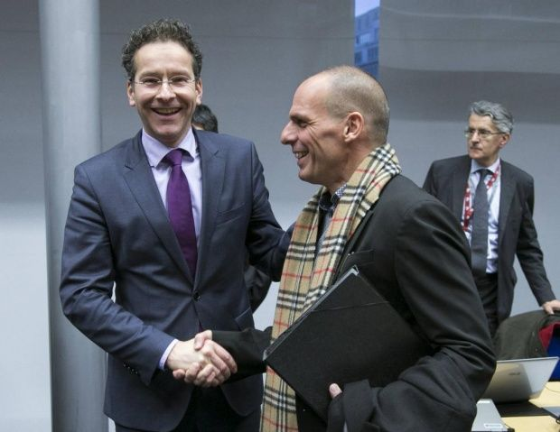 Eurogroup President Jeroen Dijsselbloem (L) greets Greek Finance Minister Yanis Varoufakis (R) during an extraordinary euro zone Finance Ministers meeting to discuss Athens' plans to reverse austerity measures agreed as part of its bailout, in Brussels February 11, 2015.