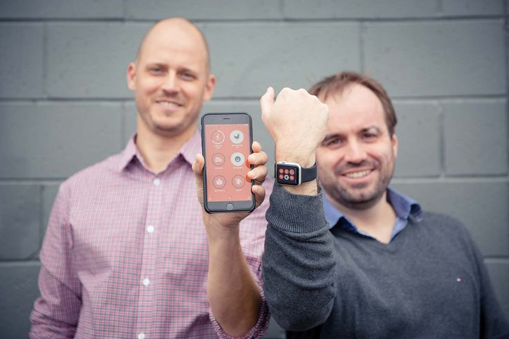 Zervaas Enterprises team members holding up Apple Watch and iPhone with Streaks app displayed.
