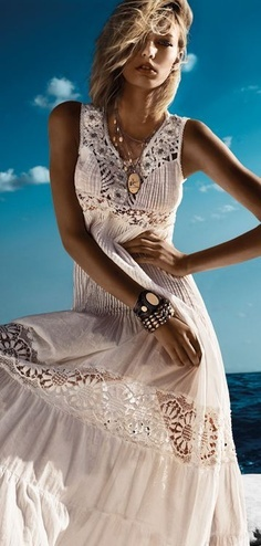 Colorful dresses or shorts, big flashy jewelry, high heels. Flowing dresses also good