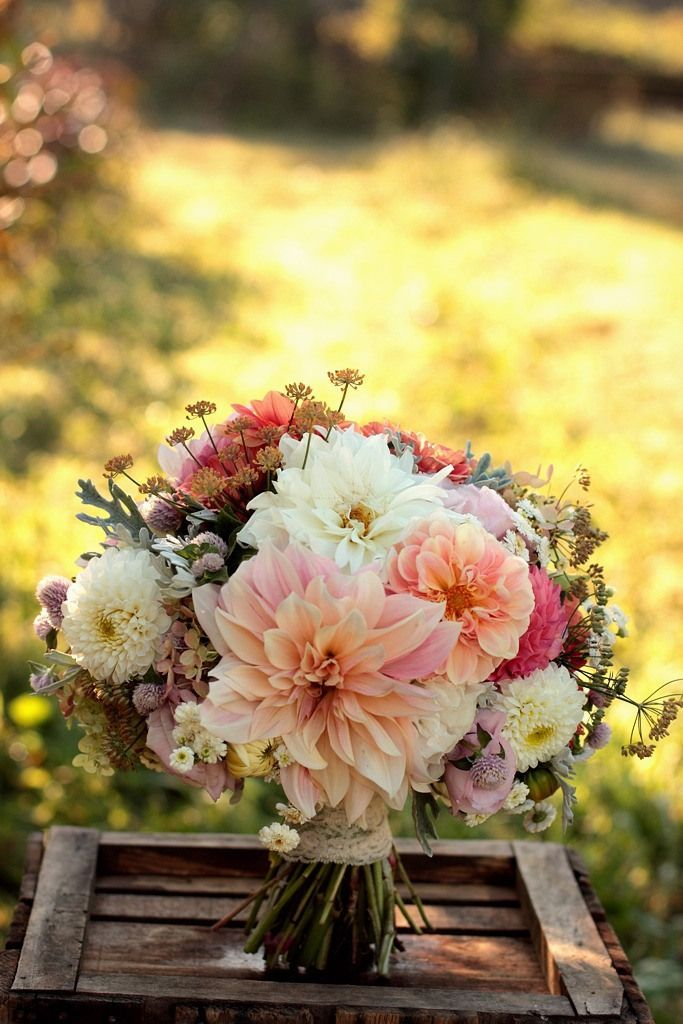 Pretty summer bouquet with dahlias and other flowers in soft peach, ivory, pink and yellow.  Lovely!