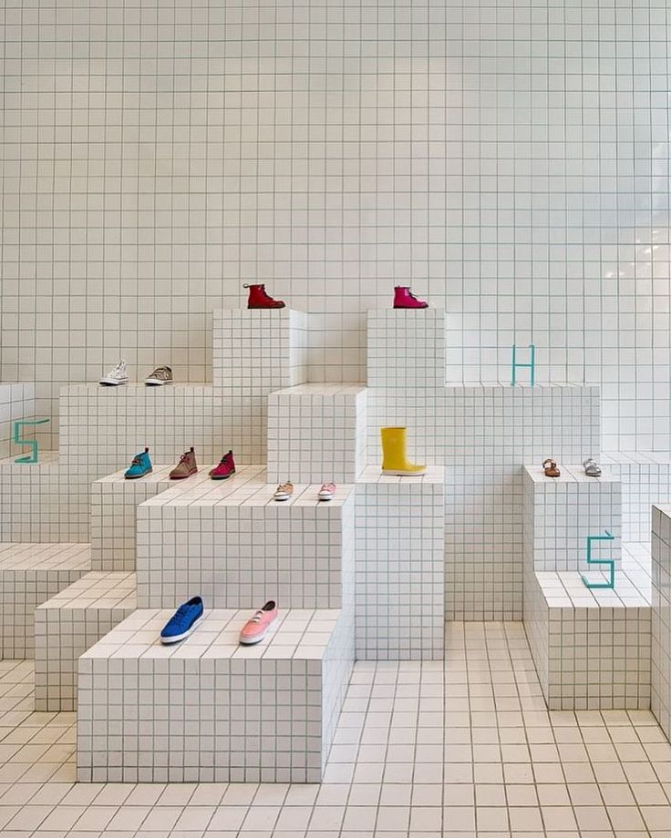 "LITTLE SHOES, (Kids Shoes Only), Barcelona, Spain, ""The space is entirely shaped by 360 degree ceramic tiles"", photo by The Fashion Display, pinned by Ton van der Veer"