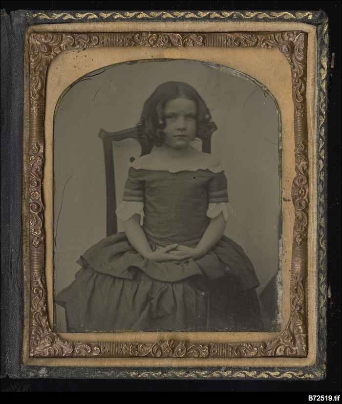 The Library's photo collection reflects the evolution of the photographer's art from the 1850s to the present. The earliest works used glass plate processes such as the Daguerreotype. From this a cheaper process was developed using a fine sheet of metal - a tintype.   Unfortunately nothing is known about the identity of the girl, circa 1870, but her dress suggests she was of a middle-class family. Taking of a portrait suggests a modest affluence that was able to afford the photographer's…