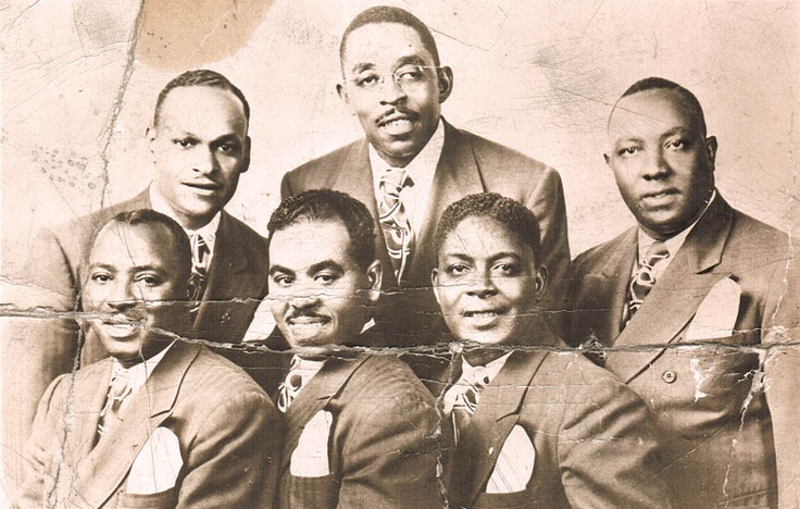 """The Harmonizing Four engaged in the 1940s equivalent of social networking. """"We started getting the names of groups, like the Soul Stirrers in Chicago,"""" Lonnie Liston Smith Sr. said in 1986. """"We'd stay with them a week or two and then they'd come here. … That's how we got known so well across the country, partnering with other groups."""" From left, Levi Hansley, Vance Joyner, Lonnie Liston Smith Sr., Thomas Johnson, founding member John Scott and """"Gospel Joe"""" Williams."""
