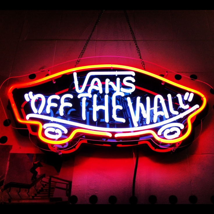 Van's off the wall. :) one of my fav shoe companies. Love neon signs gonna have my garage and game room just covered wall to wall with neon signs and cool posters and vinyl records got some major creativity for me and a few buddies to do soon :)